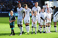 Kyle Naughton of Swansea City with a young mascot during the Sky Bet Championship match between Swansea City and Cardiff City at the Liberty Stadium in Swansea, Wales, UK. Sunday 27 October 2019