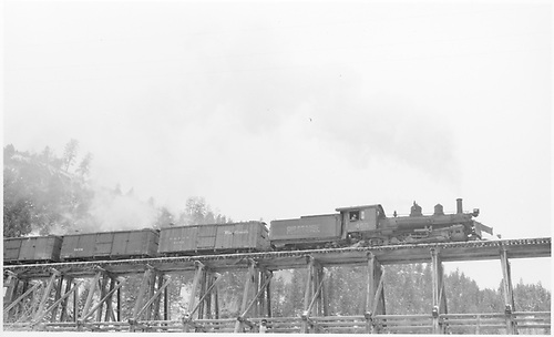 Engineer side view of RGS K-27 #455 taking a freight over bridge 22-A at Leonard.<br /> RGS  Leonard, CO  Taken by Peyton, Ernie S. - 3/29/1950