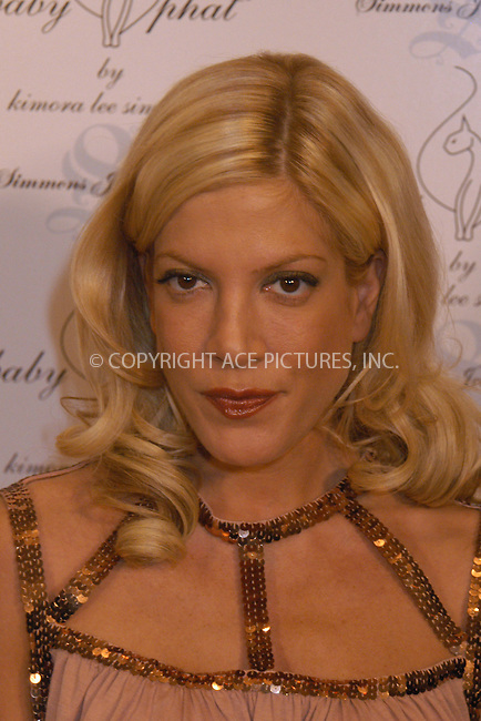 WWW.ACEPIXS.COM . . . . . ....NEW YORK, FEBRUARY 5, 2005....Tori Spelling at the Baby Phat Fall 2005 fashion show.....Please byline: KRISTIN CALLAHAN - ACE PICTURES.. . . . . . ..Ace Pictures, Inc:  ..Philip Vaughan (646) 769-0430..e-mail: info@acepixs.com..web: http://www.acepixs.com