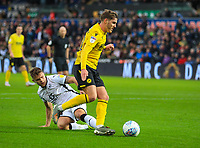 23rd November 2019; Liberty Stadium, Swansea, Glamorgan, Wales; English Football League Championship, Swansea City versus Millwall; Connor Mahoney of Millwall evades the challenge from Jack Bidwell of Swansea City - Strictly Editorial Use Only. No use with unauthorized audio, video, data, fixture lists, club/league logos or 'live' services. Online in-match use limited to 120 images, no video emulation. No use in betting, games or single club/league/player publications
