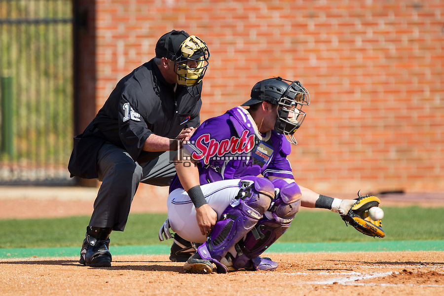 High Point Panthers catcher Josh Spano (21) catches a pitch as home plate umpire Ben Sass looks on during the game against the Coastal Carolina Chanticleers at Willard Stadium on March 15, 2014 in High Point, North Carolina.  The Chanticleers defeated the Panthers 1-0 in the first game of a double-header.  (Brian Westerholt/Sports On Film)