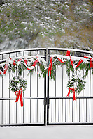 Gate with Christmas wreaths and decorations.