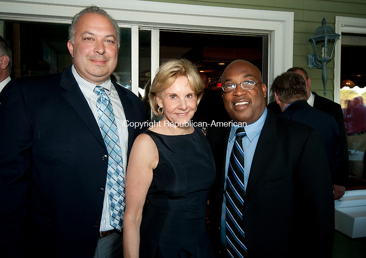 WATERBURY,  CT--- -061416JS16-  Deputy Chief Fred Spagnolo, left, event co-chair Cathy Smith and Chris Hill, President of the National Chapter of PAL; at the Waterbury Police Activities League's 10th anniversary celebration held at the Country Club of Waterbury.  <br />