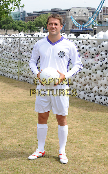 MICHAEL OWEN.Photocall for a new advertising campaign, promoting new Sky Sports 1 & Sky Sports 2 subscription packages available on the BT Vision platform, London, England..July 1st, 2010.football soccer footballer kit white shorts top uniform ball socks trainers full length.CAP/WIZ.© Wizard/Capital Pictures.
