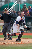 Virginia Cavaliers catcher Matt Thaiss (21) chases after a foul pop fly during the game against the Hartford Hawks at The Ripken Experience on February 27, 2015 in Myrtle Beach, South Carolina.  The Cavaliers defeated the Hawks 5-1.  (Brian Westerholt/Four Seam Images)