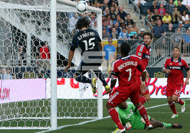 CHESTER, PA - AUGUST 12, 2012:  Gabriel Farfan (15) of the Philadelphia Union narrowly misses a goal opportunity against   Sean Johnson (25) and  Sherjill McDonald (7) of the Chicago Fire during an MLS match at PPL Park, in Chester, PA on August 12. Fire won 3-1.