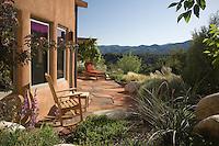 Sunny flagstone patio in New Mexico xeriscape, dry landscape, drought tolerant garden