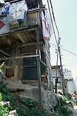 Rio de Janeiro, Brazil. Favela Dona Marta shanty town; precarious rough wooden shacks.