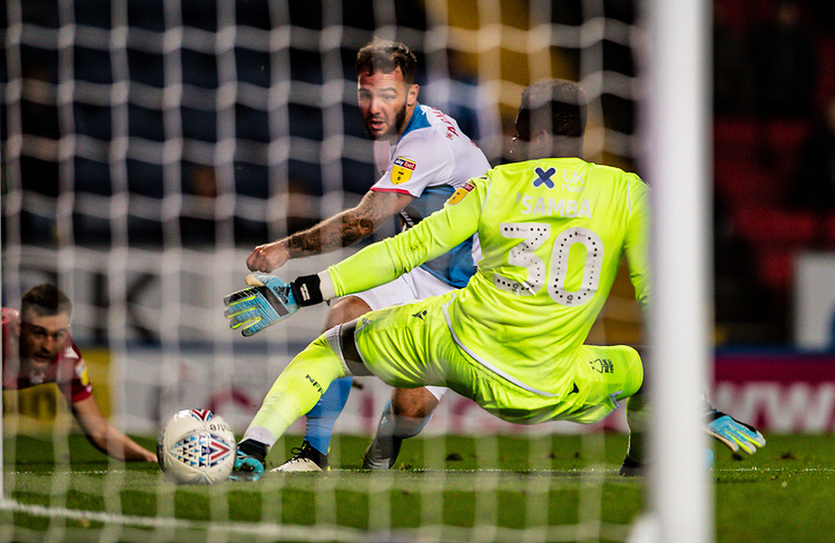 Blackburn Rovers' Adam Armstrong scoring his side's first goal past Nottingham Forest's goalkeeper Brice Samba (right) <br /> <br /> Photographer Andrew Kearns/CameraSport<br /> <br /> The EFL Sky Bet Championship - Blackburn Rovers v Nottingham Forest - Tuesday 1st October 2019  - Ewood Park - Blackburn<br /> <br /> World Copyright © 2019 CameraSport. All rights reserved. 43 Linden Ave. Countesthorpe. Leicester. England. LE8 5PG - Tel: +44 (0) 116 277 4147 - admin@camerasport.com - www.camerasport.com