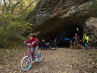 NWA Democrat-Gazette/BEN GOFF @NWABENGOFF<br /> Laurel Jones, 5, of Bella Vista rides her bicycle Saturday, Nov. 3, 2018, during the first public 'Cave Party' at Hole in the Wall NWA in Bella Vista. Guests to the free event had a chance to check out the cave while enjoying food, live music, campfires and stargazing with Explore Scientific USA. Overnight camping was also offered with a reservation. Owners Julie Duncan and Duane Paterson purchased the property three years ago with the idea of building their dream home, but are now trying to make the property a camping and event space. The 12 acre property with a cave, open meadow and woods sits only a short distance from a future addition to the Back 40 mountain bike trail system.