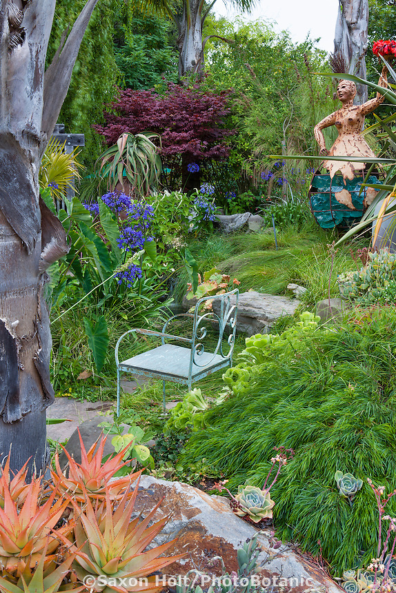 Rustic chair in California foliage cottage garden with sculpture; Sherry Merciari garden