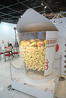 A display in the Instant Ramen Museum showing Nissin's patent system for instant ramen in a cup (cup noodle). The noodles are tightly wedged in the middle of the cup. The method both prevents them breaking up in transit, and also ensures they cook evenly. The Instant Ramen Museum in Ikeda, near the Japanese city of Osaka, has welcomed some 2 million visitors over the years. .