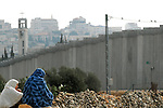 Palestinian women hang out near their house, located just outside the separation barrier surrounding Bethlehem, West Bank.