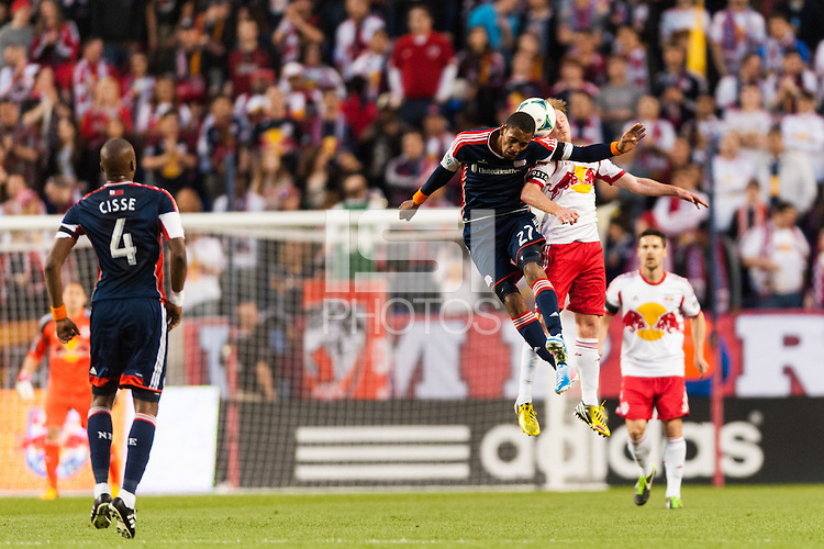 Jerry Bengtson (27) of the New England Revolution goes up for a header with Dax McCarty (11) of the New York Red Bulls. The New York Red Bulls defeated the New England Revolution 4-1 during a Major League Soccer (MLS) match at Red Bull Arena in Harrison, NJ, on March 20, 2013.