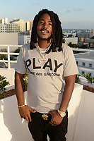 MIAMI BEACH, FL - OCTOBER 05: Mozzy poses for a portrait during the Empire Records DJ party held at Skydeck on October 5, 2018 in Miami Beach, Florida. <br /> CAP/MPI04<br /> &copy;MPI04/Capital Pictures