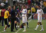 23 August 2007: Los Angeles' David Beckham (ENG) (23) talks with head coach Frank Yallop (CAN) as Chris Klein (7) walks to the bench. The Los Angeles Galaxy played Club Deportivo Chivas in a Major League Soccer regular season match at the Home Depot Center in Carson, CA.