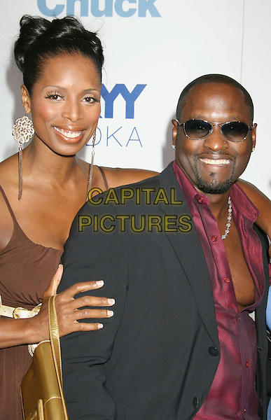 """TASHA SMITH & GUEST.""""Good Luck Chuck"""" Los Angeles Premiere held at Mann National Theater, Westwood, California, USA..September 19th, 2007.half length brown gold earrings unbuttoned chest black suit jacket sunglasses shades goatee facial hair .CAP/ADM/RE.©Russ Elliot/AdMedia/Capital Pictures."""