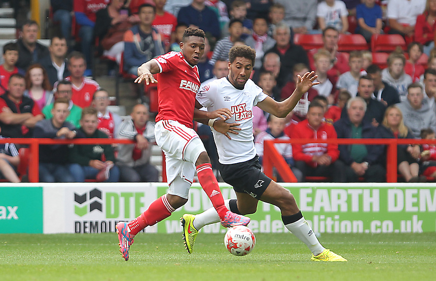 Nottingham Forest's Britt Assombalonga battles with  Derby County's Ryan Shotton<br /> <br /> Photographer Mick Walker/CameraSport<br /> <br /> Football - The Football League Sky Bet Championship - Nottingham Forest v Derby County - Sunday 14th September 2014 - The City Ground - Nottingham<br /> <br /> &copy; CameraSport - 43 Linden Ave. Countesthorpe. Leicester. England. LE8 5PG - Tel: +44 (0) 116 277 4147 - admin@camerasport.com - www.camerasport.com