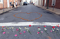 A make-shift memorial of flowers lines 4th Street SE Sunday where a woman was killed and several other injured after a Unite the Right rally in Charlottesville, Va. Photo/Andrew Shurtleff