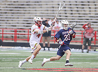 College Park, MD - May 13, 2018: Robert Morris Colonials Conner Yepsen (33) runs past Maryland Terrapins Colin Giblin (4) during the NCAA first round game between Robert Morris and Maryland at  Capital One Field at Maryland Stadium in College Park, MD.  (Photo by Elliott Brown/Media Images International)