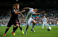 Leeds United's Mateusz Bogusz takes on Stoke City's Ryan Woods and Tommy Smith<br /> <br /> Photographer Alex Dodd/CameraSport<br /> <br /> The Carabao Cup Second Round- Leeds United v Stoke City - Tuesday 27th August 2019  - Elland Road - Leeds<br />  <br /> World Copyright © 2019 CameraSport. All rights reserved. 43 Linden Ave. Countesthorpe. Leicester. England. LE8 5PG - Tel: +44 (0) 116 277 4147 - admin@camerasport.com - www.camerasport.com