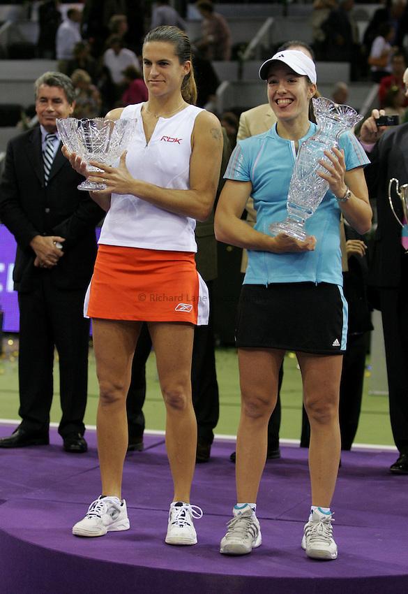 Photo: Cesar Cebolla..Sony Ericsson Championship Final. 12/11/2006.Amelie Moresmo (FRA) v  Justinne Henin-Hardene (BEL)..Justinne Henin-Hardene (rt) celebrates with the trophy with runner up, Amelie Moresmo.