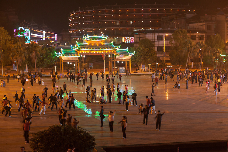 Line dancing is popular in China, as demonstrated at Sanjiang's city center.