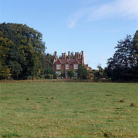 A view of the rectory with its many chimneys from across the field