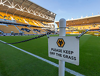 4th January 2020; Molineux Stadium, Wolverhampton, West Midlands, England; English FA Cup Football, Wolverhampton Wanderers versus Manchester United; A Please Keep Off The Grass Sign on pitch side with the stand in the background - Strictly Editorial Use Only. No use with unauthorized audio, video, data, fixture lists, club/league logos or 'live' services. Online in-match use limited to 120 images, no video emulation. No use in betting, games or single club/league/player publications
