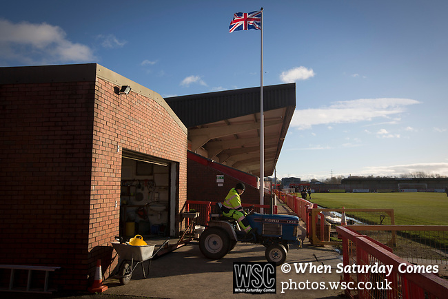 Witton Albion 1 Warrington Town 2, 26/12/2017. Wincham Park, Northern Premier League. A groundsman on his tractor beside the pitch at Wincham Park, home of Witton Albion before their Northern Premier League premier division fixture with Warrington Town. Formed in 1887, the home team have played at their current ground since 1989 having relocated from the Central Ground in Northwich. With both team chasing play-off spots, the visitors emerged with a 2-1 victory, the winner being scored by Tony Gray in second half injury time, watched by a crowd of 503. Photo by Colin McPherson.