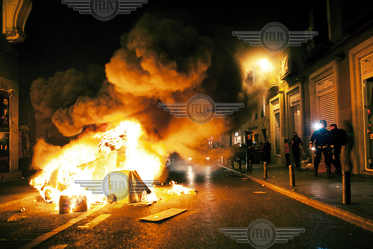 A car on fire on a street in Madrid during the general strike on March 29. The strike was sponsored by the trade union to protest new austerity measures which allow cheaper hirings and dismissals of workers.