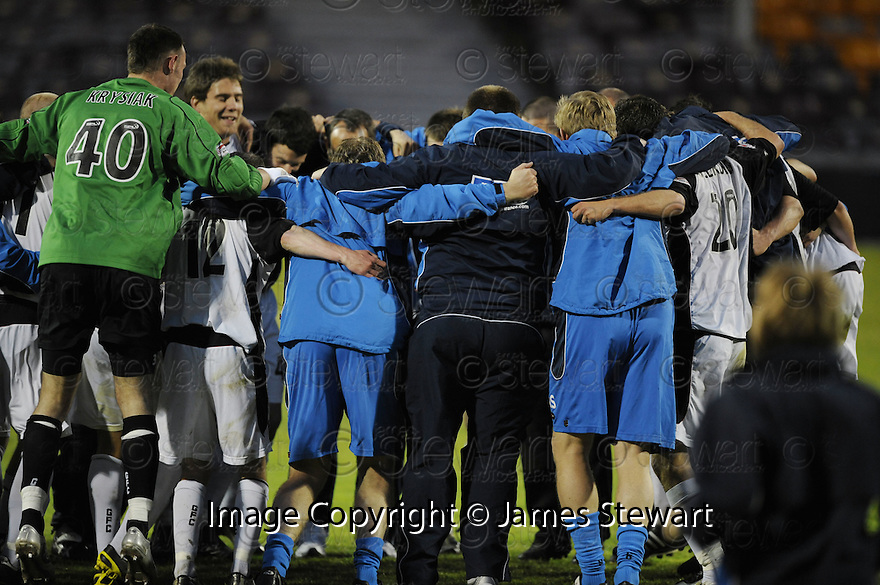 13/05/2008   Copyright Pic: James Stewart.File Name : sct_jspa18_gretna_v_hearts.GRETNA PLAYER FORM A HUDDLE AT THE END OF THE GAME....James Stewart Photo Agency 19 Carronlea Drive, Falkirk. FK2 8DN      Vat Reg No. 607 6932 25.Studio      : +44 (0)1324 611191 .Mobile      : +44 (0)7721 416997.E-mail  :  jim@jspa.co.uk.If you require further information then contact Jim Stewart on any of the numbers above........