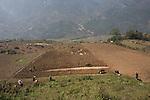 Black Hmong family cultivating farm field, Vietnam