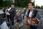 Joel Rodriguez leads singing outside the Federal Detention Center in Seatac, Washington, during a June 24 prayer vigil in support of immigrant parents inside the prison who've been separated from their children. Behind him is David Reinholz.  Rodriguez is a United Methodist pastor of a new church start in Sunnyside, Washington.