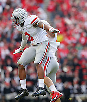 Ohio State Buckeyes linebacker Ryan Shazier (2) celebrates with Ohio State Buckeyes linebacker Joe Burger (48) after sacking Purdue Boilermakers quarterback Danny Etling (5) during Saturday's NCAA Division I football game at Ross-Ade Stadium in West Lafayette, In. on November 2, 2013. (Barbara J. Perenic/The Columbus Dispatch)