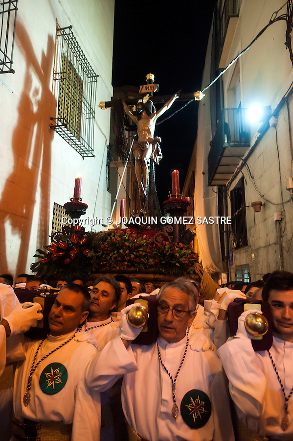 The costaleros of the Brotherhood of the Holy Cross in the sea procession of Christ through the streets of the old town of Alicante