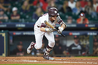 Jake Mangum (15) of the Mississippi State Bulldogs is hit in the wrist by the baseball after laying down a bunt against the Houston Cougars in game six of the 2018 Shriners Hospitals for Children College Classic at Minute Maid Park on March 3, 2018 in Houston, Texas. The Bulldogs defeated the Cougars 3-2 in 12 innings. (Brian Westerholt/Four Seam Images)