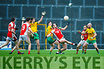 Donal O'Sullivan Rathmore and Padraig O'Connor Gneeveguilla battle for the dropping ball