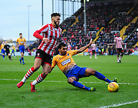 Lincoln City's Kellan Gordon vies for possession with  Mansfield Town's Malvind Benning<br /> <br /> Photographer Andrew Vaughan/CameraSport<br /> <br /> The EFL Sky Bet League Two - Lincoln City v Mansfield Town - Saturday 24th November 2018 - Sincil Bank - Lincoln<br /> <br /> World Copyright &copy; 2018 CameraSport. All rights reserved. 43 Linden Ave. Countesthorpe. Leicester. England. LE8 5PG - Tel: +44 (0) 116 277 4147 - admin@camerasport.com - www.camerasport.com