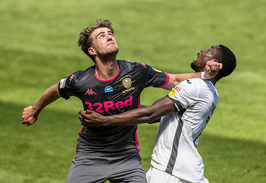 Leeds United's Patrick Bamford competing with Swansea City's Marc Guehi (right)  <br /> <br /> Photographer Andrew Kearns/CameraSport<br /> <br /> The EFL Sky Bet Championship - Swansea City v Leeds United - Sunday 12th July 2020 - Liberty Stadium - Swansea<br /> <br /> World Copyright © 2020 CameraSport. All rights reserved. 43 Linden Ave. Countesthorpe. Leicester. England. LE8 5PG - Tel: +44 (0) 116 277 4147 - admin@camerasport.com - www.camerasport.com