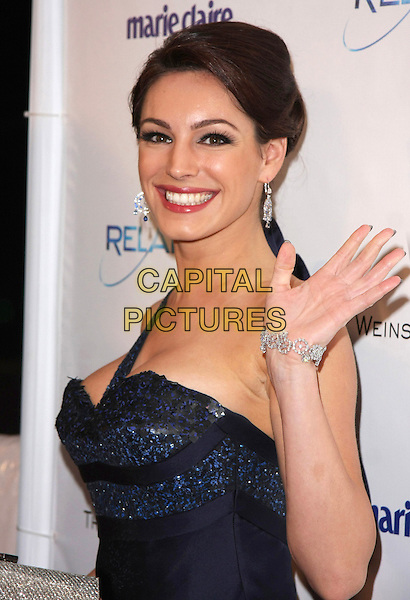 KELLY BROOK.Relativity Weinstein Company 68th Annual Golden Globe Awards After Party Presented by Marie Claire held at the Beverly Hilton, Beverly Hills, California, USA..January 16th, 2011.half length black purple blue navy one shoulder hand silver bracelet hair up smiling.CAP/ADM/TB.©Tommaso Boddi/AdMedia/Capital Pictures.