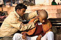 Shaving the head on visiting the Ganges is thought to bring spiritual purification. (Photo by Matt Considine - Images of Asia Collection)