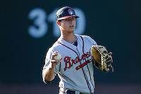 Catcher Tanner Murphy (14) of the Rome Braves warms up before a game against the Greenville Drive on Friday, June 12, 2015, at Fluor Field at the West End in Greenville, South Carolina. Greenville won, 10-8. (Tom Priddy/Four Seam Images)