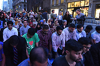NEW YORK, USA - JUNE 01 :  Participants  are praying in the Iftar at Trump Tower event of the  M Power Change social organization  and the New York State Immigrant Action Fund to bring New York Muslim communities together for an Iftar at Trump Tower during Ramadan on June 01,2017 in New York. Joana Toro/VIEW press