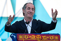"""Luca Zaia (Member of Liga Veneta–Lega/League, President of Veneto Region, former Minister of Agriculture in Silvio Berlusconi's IV Government).<br /> <br /> Rome, 19/10/2019. Today, tens thousands of people (200,000 for the organisers, 50,000 for the police) gathered in Piazza San Giovanni to attend the national demonstration """"Orgoglio Italiano"""" (Italian Pride) of the far-right party Lega (League) of Matteo Salvini. The demonstration was supported by Silvio Berlusconi's party Forza Italia and Giorgia Meloni's party Fratelli d'Italia (Brothers of Italy, right-wing).  <br /> The aim of the rally was to protest against the Italian coalition Government (AKA Governo Conte II, Conte's Second Government, Governo Giallo-Rosso, 1.) lead by Professor Giuseppe Conte. The 66th Government of Italy is a coalition between Five Star Movement (M5S, 2.), Democratic Party (PD – Center Left, 3.), and Liberi e Uguali (LeU – Left, 4.), these last two parties replaced Lega / League as new members of a coalition based on Parliamentarian majority as stated in the Italian Constitution. The Governo Conte I (Conte's First Government, 5.) was 14-month-old when, between 8 and 9 of August 2019, collapsed after the Interior Minister Matteo Salvini withdrew his euroskeptic, anti-migrant, right-wing Lega / League (6.) from the populist coalition in a pindaric attempt (miserably failed) to trigger a snap election.<br /> <br /> Footnotes & Links:<br /> 1. http://bit.do/feK6N<br /> 2. http://bit.do/e7JLx<br /> 3. http://bit.do/e7JKy<br /> 4. http://bit.do/e7JMP<br /> 5. http://bit.do/e7JH7<br /> 6. http://bit.do/eE7Ey<br /> https://www.leganord.org<br /> http://bit.do/feK9X (Source, TheGuardian.com)<br /> Reportage: """"La Fabbrica Della Paura"""" (The Factory of Fear): http://bit.do/feLcy (Source Report, Rai.it - ITA)<br /> (Update) Reportage: """"La Fabbrica Social Della Paura"""" (The Social Network Factory of Fear): http://bit.do/fe8Pn (Source Report, Rai.it - ITA)"""