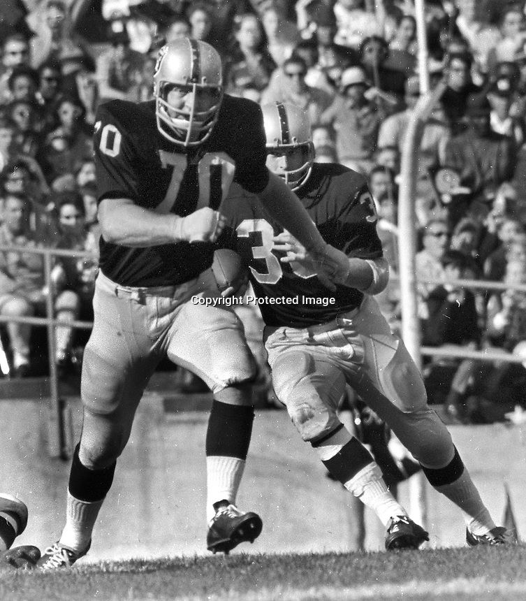 Oakland Raider #70 Jim Harvey blocking for Roger Hagberg...(1969 photo by Ron Riesterer)