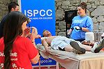 James kelly giving a bit of a waxing to Cian Nolan<br /> ISPCC Charity Leg Wax<br /> Picture:  Fran Caffrey / www.newsfile.ie