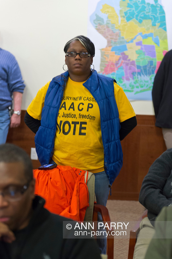 January 3, 2013 - Mineola, New York, U.S. -  An audience member wears a Westbury/New Cassel NAACP tee-shirt at the Nassau County Districting Advisory Commission's night time meeting on two Redistricting maps for the 19 Legislative Districts, one proposed by Republicans, one by Democrats. In the standing room only chambers, dozens shared their views with the commission during the Public Comment segment. After a brief recess, the commission voted at 10:40 PM for each map, neither of which passed. By January 5 it must complete its work for the Nassau Legislature, which must pass a Redistricting map by March 5, 2013.