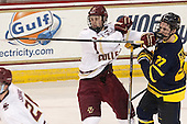Adam Gilmour (BC - 14), Justin Mansfield (Merrimack - 27) - The Boston College Eagles defeated the visiting Merrimack College Warriors 2-1 on Wednesday, January 21, 2015, at Kelley Rink in Conte Forum in Chestnut Hill, Massachusetts.