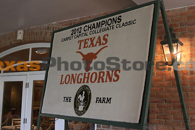 A 2012 championship banner for the University of Texas sits outside the clubhouse during the Carpet Capital Collegiate at The Farm Golf Club in Rocky Face, Ga., on Sunday, Sept. 8. The Longhorns return to The Farm as defending champions after shooting a 13-under 851 in 2012.<br /> <br /> Photo by Patrick Smith